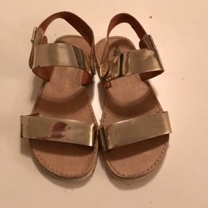 Size 10 (toddler) gold shoes